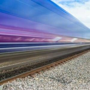 54738567 - close up of train speeding through english countryside on bright sunny day with extended exposure for extended   motion blur